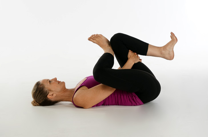 Ayurveda vata pacifying yoga supine pigeon stretch for Floor yoga stretches